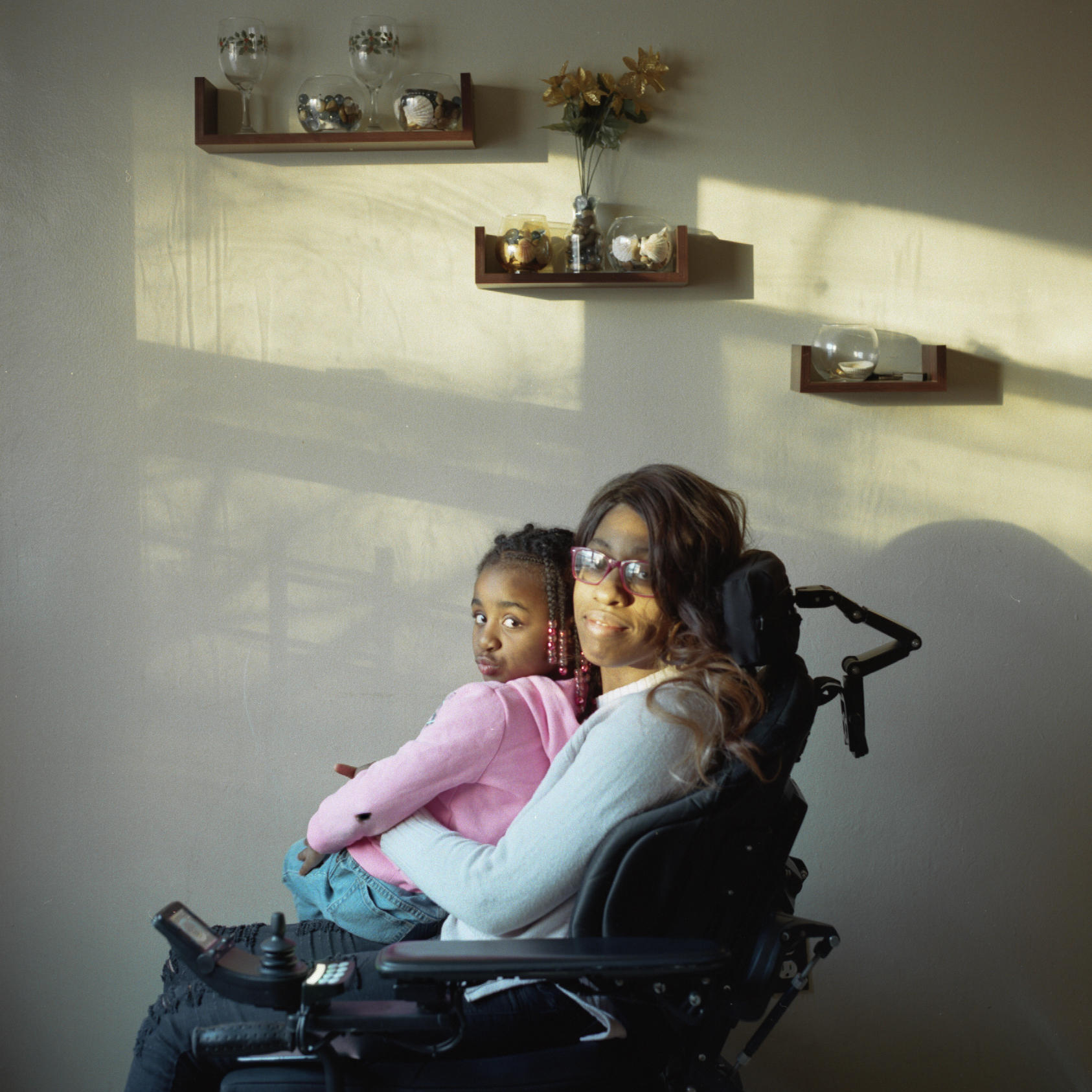 Woman and child in wheelchair by Nolan Ryan Trowe